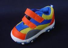 De schoen van de baby Stock Afbeeldingen