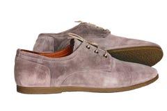 De schoenen beige kleuren van suèdemensen Stock Afbeeldingen