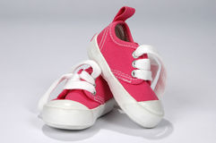 De Schoenen van de baby in Heet Roze Royalty-vrije Stock Foto