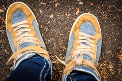 De schoenen van de fotograaf Stock Foto's