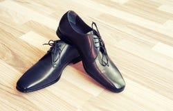 De schoenen van de mensen van het leer Stock Foto