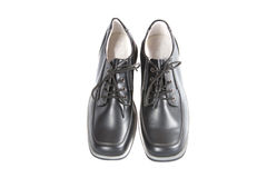De schoenen van de school voor de jongen. Wij treffen voor school voorbereidingen. Stock Fotografie