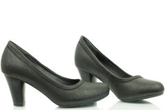 De schoenen van vrouwen met een hiel in zwarte kleur Stock Foto