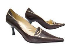 De schoenen van Womans op een witte achtergrond royalty-vrije stock foto