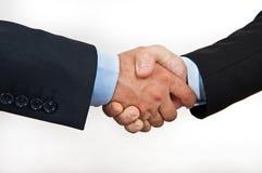 De schok van de hand tussen businessmans die op whit wordt geïsoleerdt Stock Foto