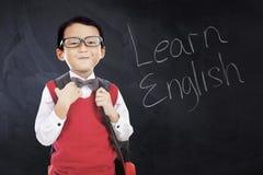 De schooljongen met tekst leert het Engels Royalty-vrije Stock Afbeelding