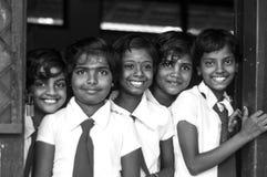 De schoolmeisjes glimlachen Stock Afbeeldingen