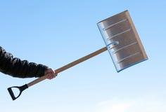 De schop van de handholding voor sneeuwverwijdering Stock Afbeelding