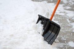 De schop van de sneeuw Stock Afbeeldingen