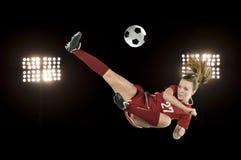 De schop van het voetbal met lichten stock afbeeldingen