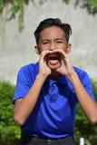 De schreeuwende Jongen van de Minderheidstiener stock afbeelding