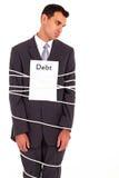 De schuld van de zakenman royalty-vrije stock afbeeldingen