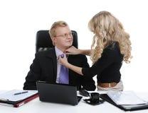 De secretaresse verbetert de directeursband Stock Afbeeldingen