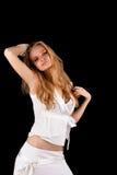 De sensuele jonge blonde vrouw van de hartstocht in witte kleding Stock Foto's