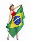 De sensuele vlag van de holdingsbrazilië van de voetbalverdediger stock afbeelding