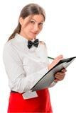De serveerster in rode schort ontvangt orde royalty-vrije stock afbeeldingen