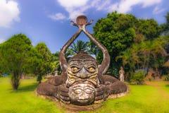 26 de setembro de 2014: Estátua de pedra budista no parque da Buda, Laos Foto de Stock