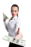 De sexy bedrijfsvrouw geeft een dollar met uitdagendheid stock foto
