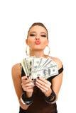 De sexy donkerbruine dollars van de meisjesholding op een witte achtergrond Royalty-vrije Stock Fotografie