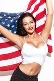 De sexy donkerbruine vlag van de V.S. van de vrouwenholding stock foto's