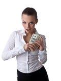De sexy jonge bedrijfsvrouw neemt veel geld Stock Foto's