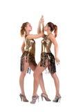 De sexy vrouwen die in goud stellen gaan-gaan geïsoleerdo kostuum Royalty-vrije Stock Foto's