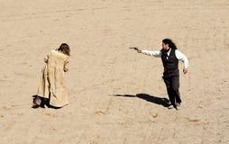De Sheriff en de Bandiet van de afgevaardigde shootout Stock Foto's