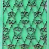 De sierstof van de smeedijzer groene muur grunge royalty-vrije stock fotografie