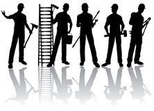 De silhouetten van arbeiders Stock Foto's