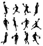 De silhouetten van de Basketballlspeler Royalty-vrije Stock Fotografie