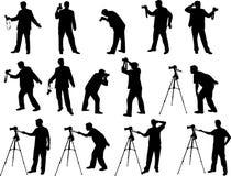 De silhouetten van de fotograaf Stock Foto