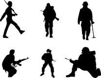 De silhouetten van de militair Stock Foto