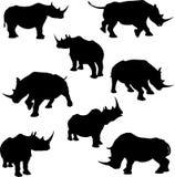 De Silhouetten van de rinoceros Stock Foto's