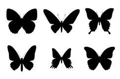 De silhouetten van de vlinder Stock Foto's