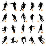 De silhouetten van de voetballer Royalty-vrije Stock Foto's