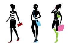 De silhouetten van de vrouw Stock Foto's