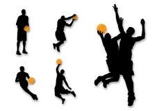 De silhouetten van het basketbal Stock Foto's