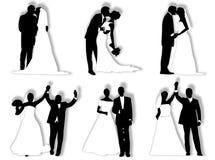 De silhouetten van het huwelijk Stock Fotografie