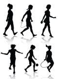 De silhouetten van het meisje het spelen Royalty-vrije Stock Afbeelding