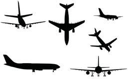 De silhouetten van het vliegtuig Stock Foto