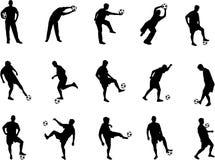 De silhouetten van het voetbal Stock Fotografie