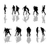 De silhouetten van het voetbal Stock Afbeelding