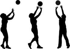 De silhouetten van het volleyball Stock Foto's