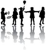 De silhouetten van jonge geitjes Royalty-vrije Stock Afbeelding