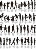De silhouetten van jonge geitjes Royalty-vrije Stock Afbeeldingen