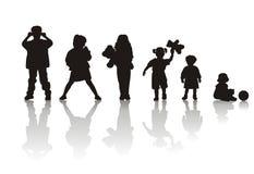 De silhouetten van kinderen Stock Afbeelding