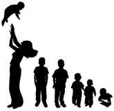 De silhouetten van kinderen Stock Foto's