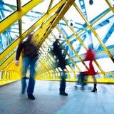 De silhouetten van mensen in motie in passage Royalty-vrije Stock Foto's