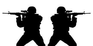 De silhouetten van Riflemens Stock Foto