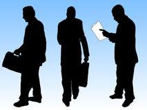 De silhouetten van zakenlieden royalty-vrije stock fotografie